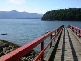 View from Bowen Island of ocean, mountains, and pier
